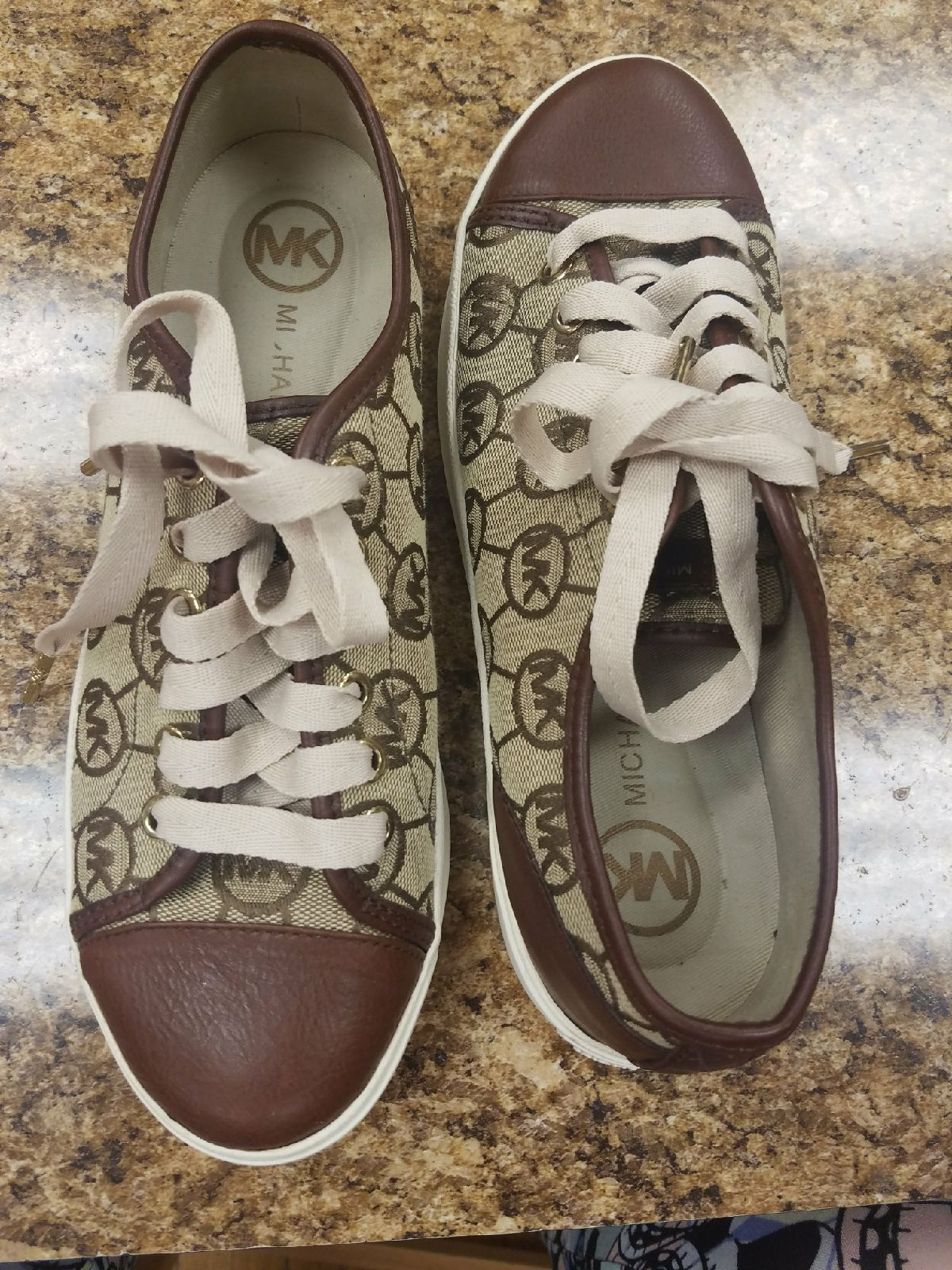Micheal Kors size 7 1/2.  Brown and tan
